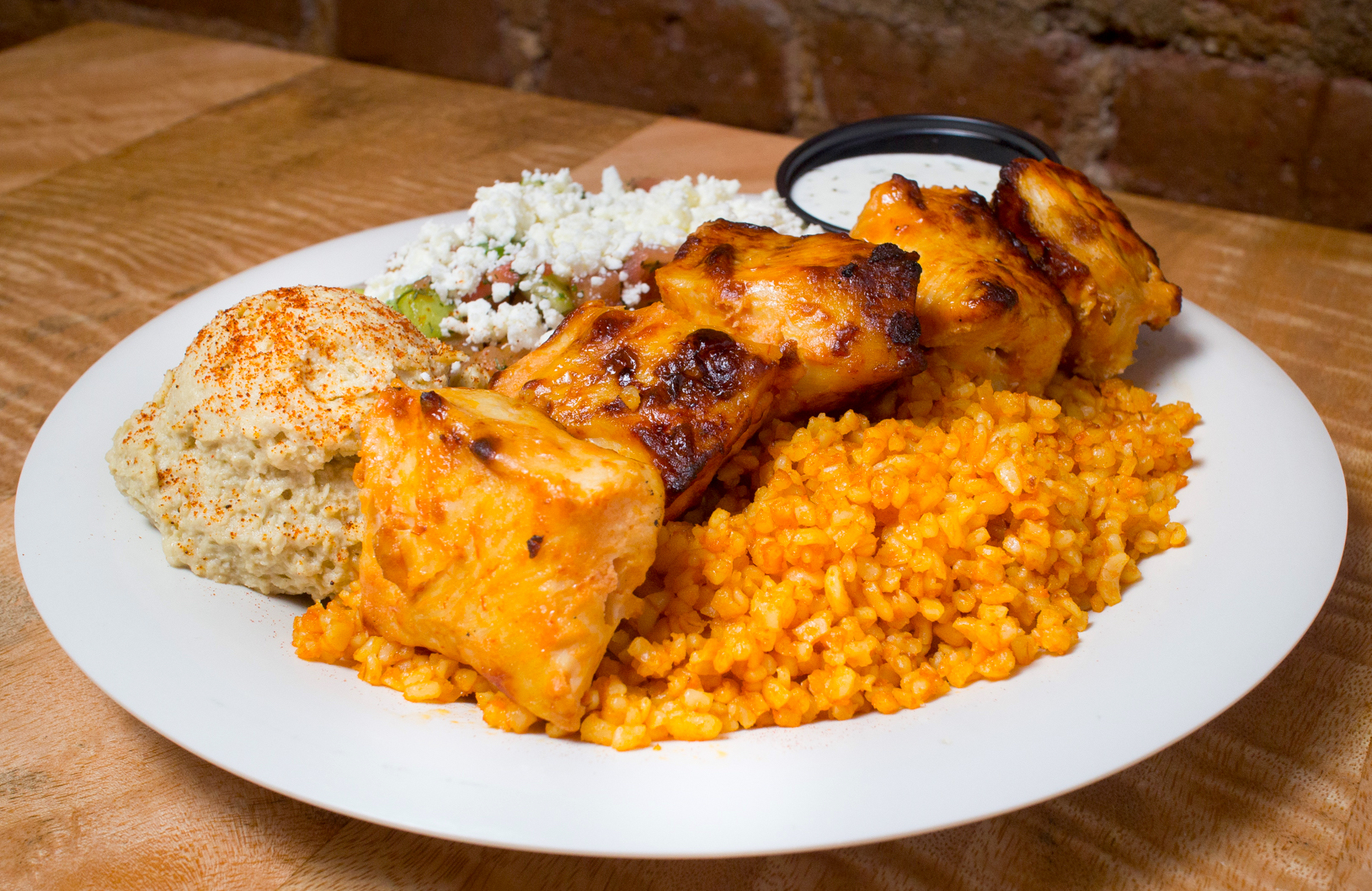 A Flat-Top Platter with rice, chicken and other specialties.