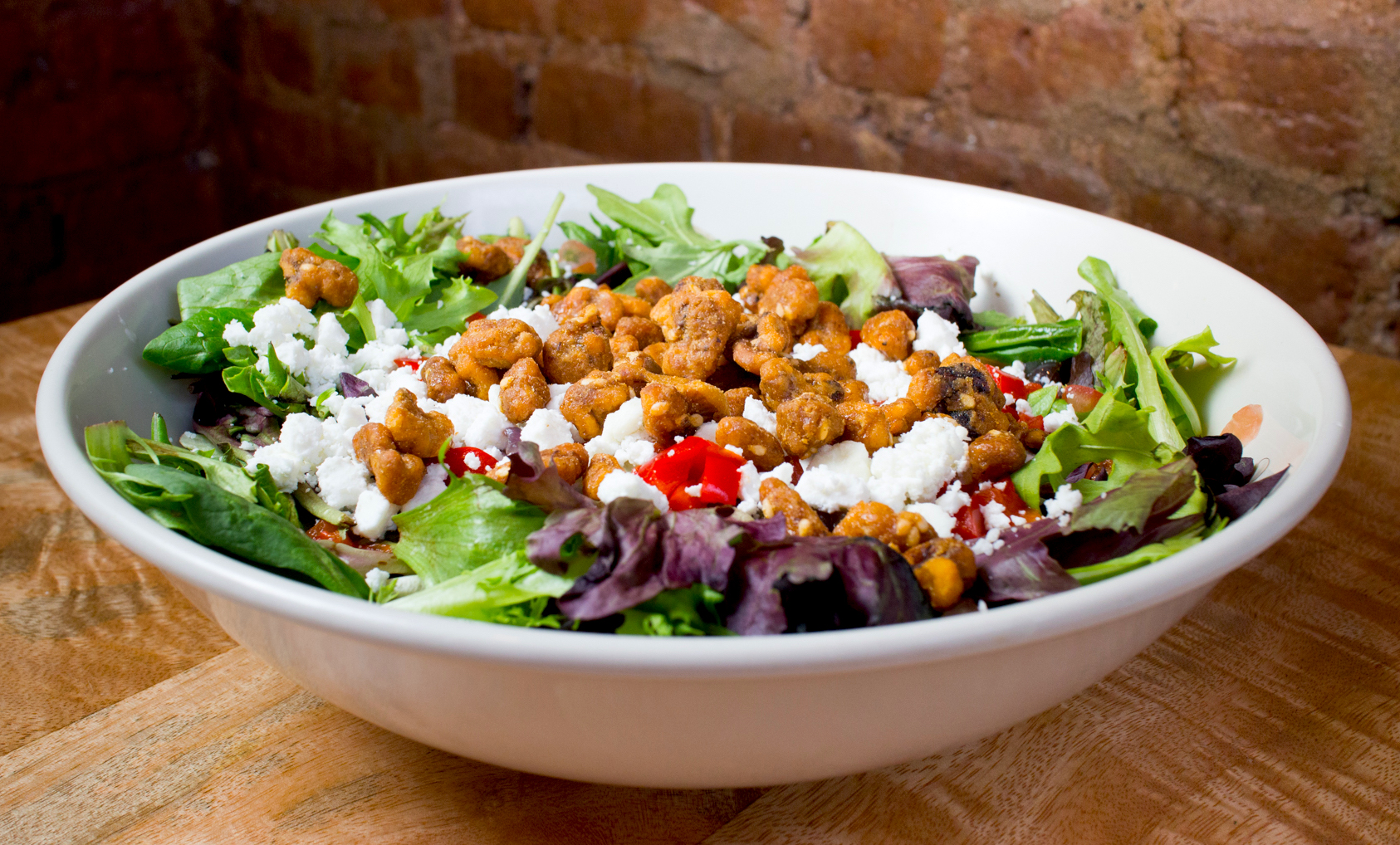 A salad with some of Flatbread Grill's famous toppings.